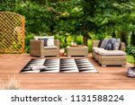 geometrical rug and rattan... | Shutterstock . vector #1131588224