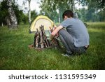 yellow tent camping. glade... | Shutterstock . vector #1131595349