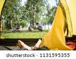 yellow tent camping. glade... | Shutterstock . vector #1131595355