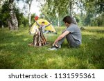 yellow tent camping. glade... | Shutterstock . vector #1131595361