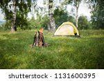 yellow tent on the nature.... | Shutterstock . vector #1131600395
