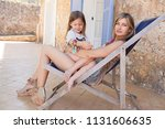 fashionable mother and child...   Shutterstock . vector #1131606635