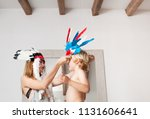 brother and sister playing...   Shutterstock . vector #1131606641