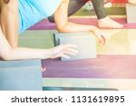 group of people practicing yoga ... | Shutterstock . vector #1131619895