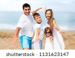 young family on sand beach | Shutterstock . vector #1131623147