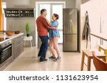 happy mature couple dancing in... | Shutterstock . vector #1131623954
