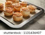 baking tray with apple roses... | Shutterstock . vector #1131636407