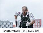 man dressed in a bulletproof... | Shutterstock . vector #1131637121