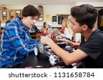 two male pupils building... | Shutterstock . vector #1131658784