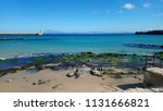 empty beach view with sea rocks ... | Shutterstock . vector #1131666821