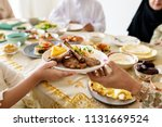 muslim family having a ramadan... | Shutterstock . vector #1131669524