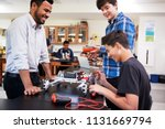 teacher with male pupils... | Shutterstock . vector #1131669794