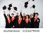 happy students in bachelor... | Shutterstock . vector #1131679034