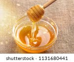 honey and  wooden spoon  on... | Shutterstock . vector #1131680441