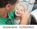 close up caring father gently...   Shutterstock . vector #1131692621