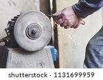 an employee carries a... | Shutterstock . vector #1131699959