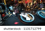 table served in halloween style.... | Shutterstock . vector #1131712799