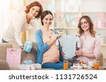 smiling pregnant woman with... | Shutterstock . vector #1131726524