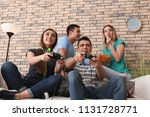 young people playing video... | Shutterstock . vector #1131728771