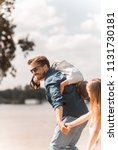 father carrying son on shoulder ... | Shutterstock . vector #1131730181