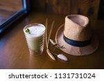 milk shake with green matcha... | Shutterstock . vector #1131731024