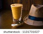 milk shake with orange and sea... | Shutterstock . vector #1131731027