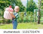children and sweets. a little...   Shutterstock . vector #1131731474