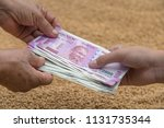 hand giving indian 500 and 2000 ... | Shutterstock . vector #1131735344