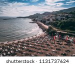 nice sunny beach with umbrellas ... | Shutterstock . vector #1131737624