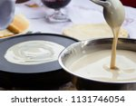 pour batter for pancakes into a ... | Shutterstock . vector #1131746054