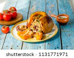 stuffed pumpkin with rice  | Shutterstock . vector #1131771971