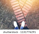 top view of selfie feet on old... | Shutterstock . vector #1131776291