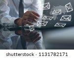 business man sending email ... | Shutterstock . vector #1131782171