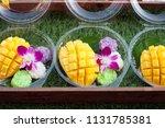 yellow sliced mango fruit and... | Shutterstock . vector #1131785381
