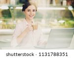 young attractive smiling... | Shutterstock . vector #1131788351