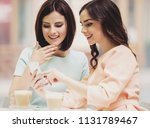 two young attractive smiling... | Shutterstock . vector #1131789467