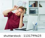 upset young woman sitting at... | Shutterstock . vector #1131799625