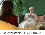 young woman with grandmother... | Shutterstock . vector #1131815687