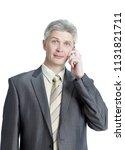 senior businessman talking on...   Shutterstock . vector #1131821711