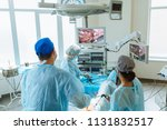team surgeon at work on... | Shutterstock . vector #1131832517