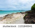 rocky coast and white sand...   Shutterstock . vector #1131840041