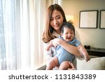 young mother carry her baby at... | Shutterstock . vector #1131843389