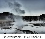 a geyser ejects hot water and... | Shutterstock . vector #1131852641