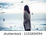 Girl In A Coat Feed Seagulls O...
