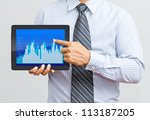 Businessman present a chart on digital tablet - stock photo