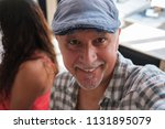 handsome middle age man selfie... | Shutterstock . vector #1131895079