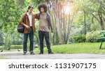 asian man travelers walking in... | Shutterstock . vector #1131907175