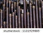 oil drill pipe. rusty drill... | Shutterstock . vector #1131929885