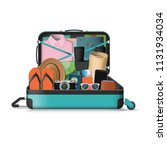 opened travel suitcase full of... | Shutterstock . vector #1131934034
