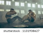 man and woman during exercises... | Shutterstock . vector #1131938627